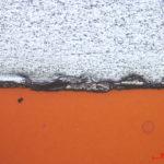 White = CRS, Dark/black area = Rust, Orange = Metal substrate